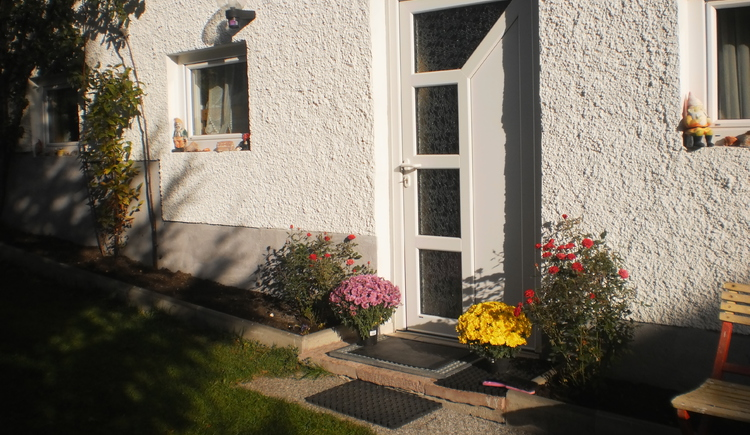 Entrance to the holiday house with beautiful flowers