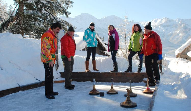 Curling has a long tradition in the Dachstein-Salzkammergut region and is a popular winter sport for young and old.