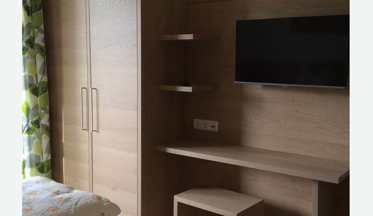 Wardrobe, television, stool