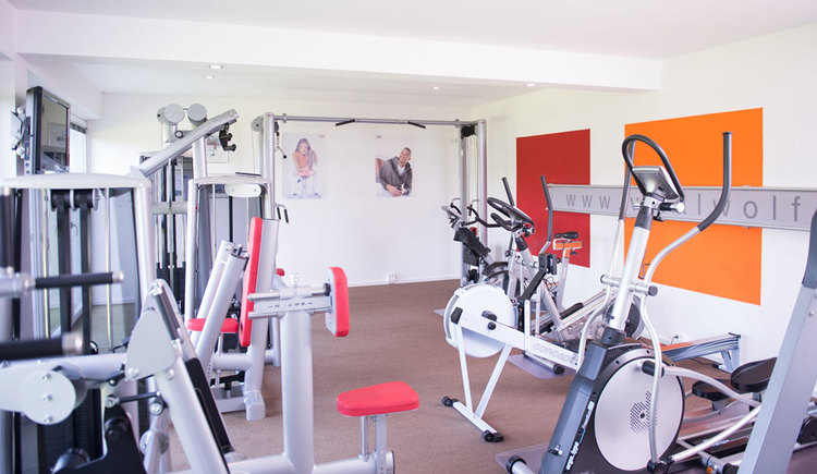 Fitness room with different equipments