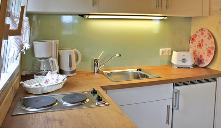 kitchen with cooker, coffee machine, kettle, kitchen sink, toaster\n