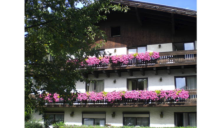 View of the house with balcony and flowers