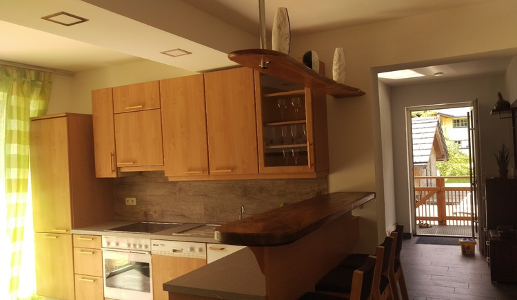 The fully equipped kitchen offers enough space.